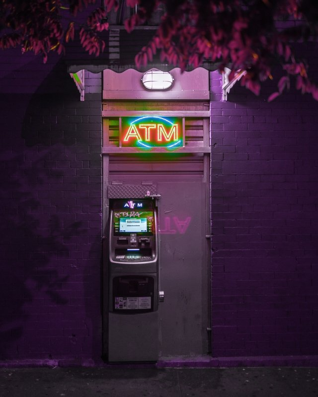 ATM machine in purple where you can get cash when working and traveling