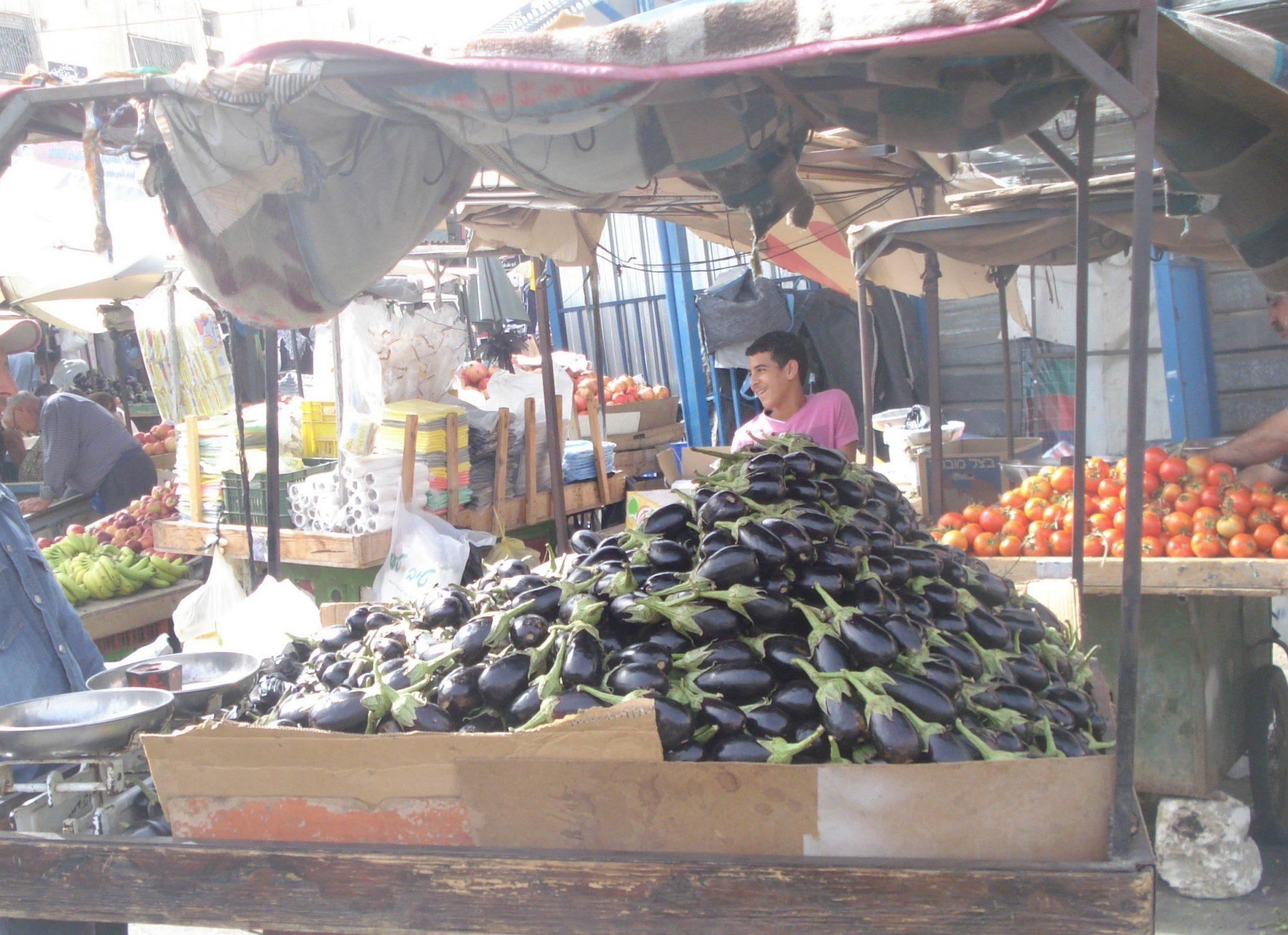 Eggplants for sale on a cart in the Middle East marketplace in Jenin, West Bank