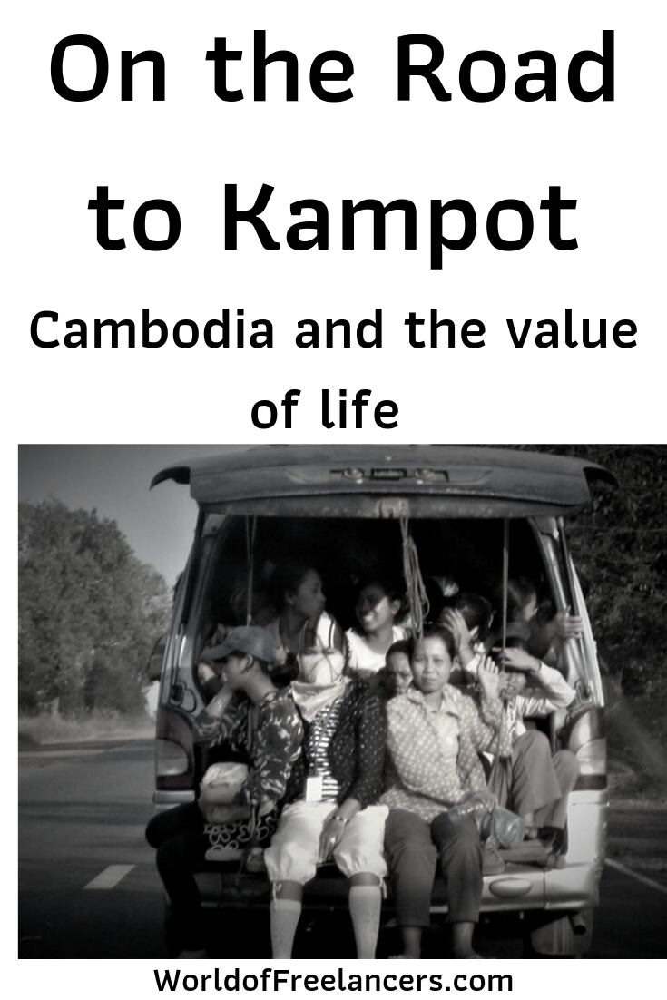 People crammed into the back of a van on the road to Kampot, Cambodia