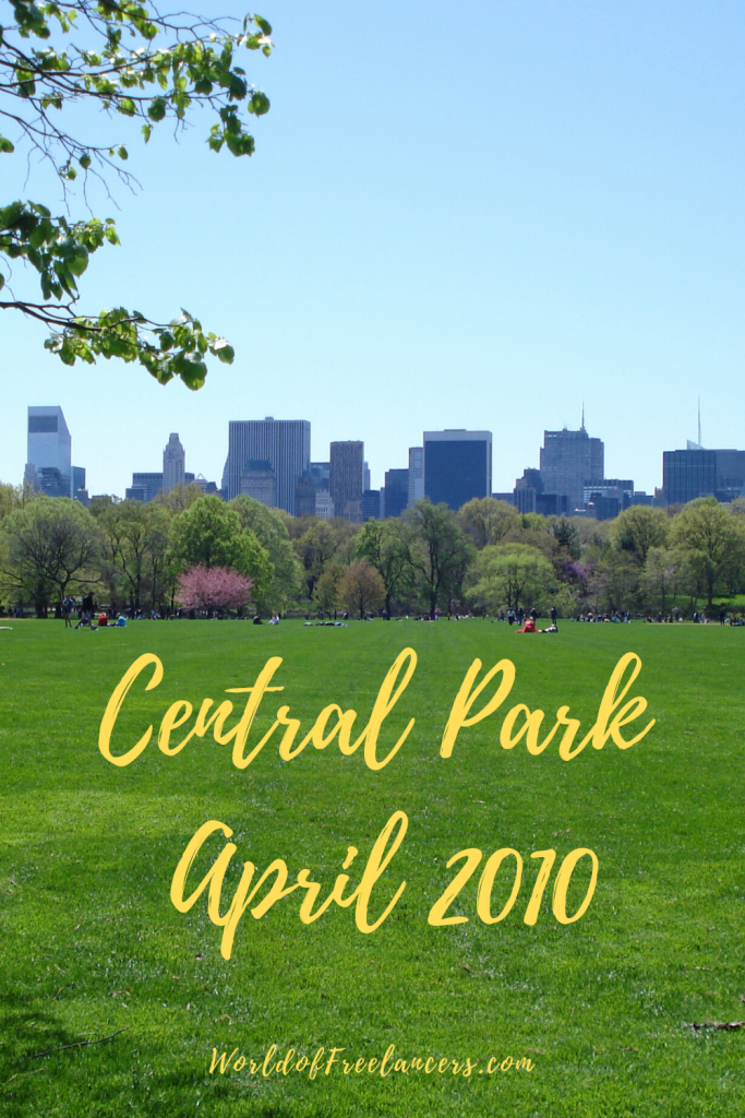 Lush green grass with dozens of buildings in the background scene from Central Park in April 2010