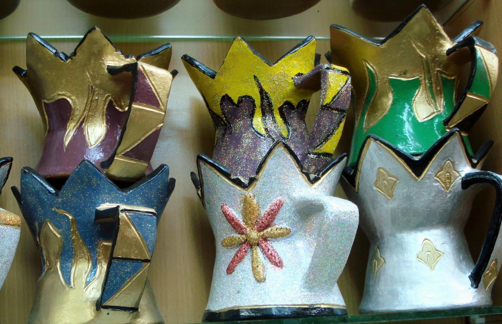 Colorful frankincense burners on a shelf