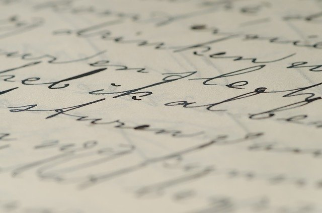 Cursive handwriting on beige paper