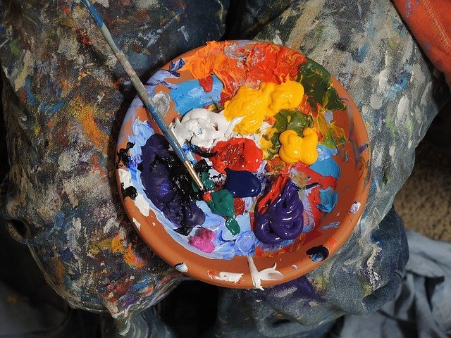 Learn how to become a freelance artist and earn money using the colorful paints in the small bowl in this photo