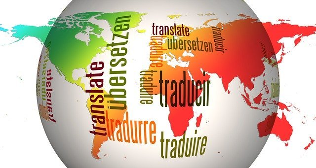 """White globe with the word """"translate"""" translated into several different languages"""