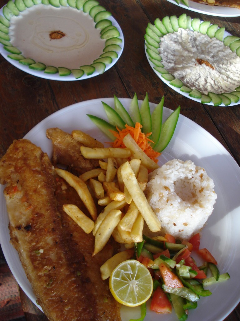 Fresh fish, french fries, rice and vegetables served at a restaurant at the Blue Hole, Egypt