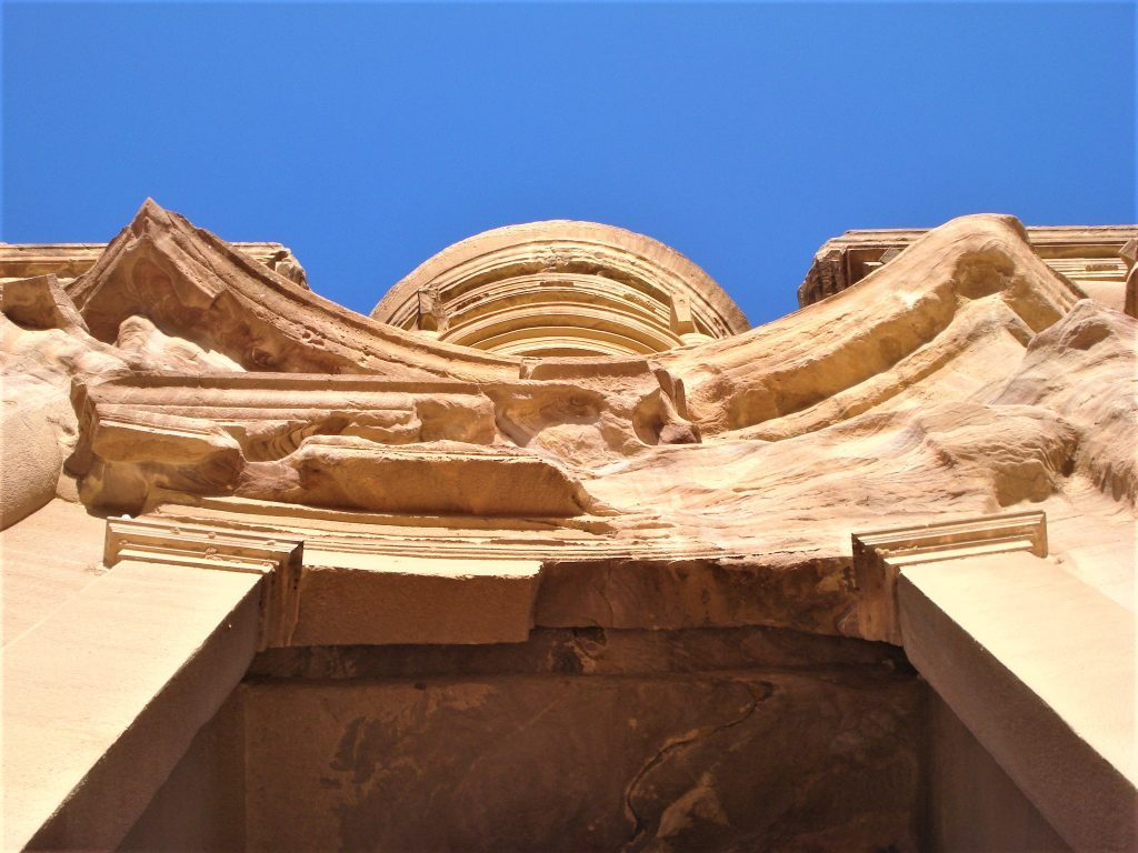 Exterior of the Petra Monastery built into the mountain after climbing 800 steps to see it.
