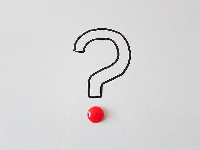Black outline of a question mark with a shiny red dot at the bottom