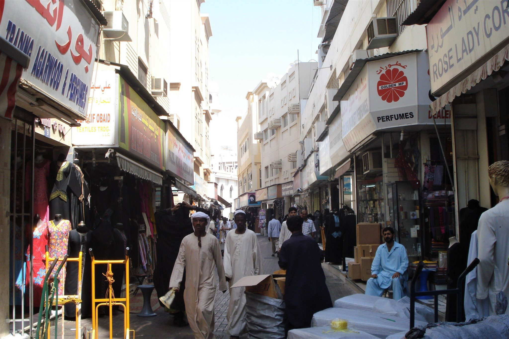 People on the narrow streets of a souq in Sharjah, United Arab Emirates