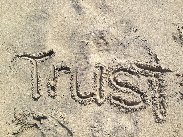 Trust, an essential component of good client communication, written in the sand
