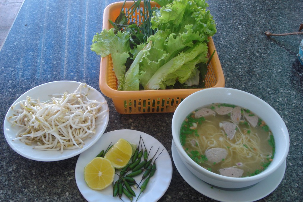 Ingredients for pho in four separate dishes