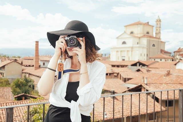 Woman tourist taking photo has some tips about safety for solo female travelers