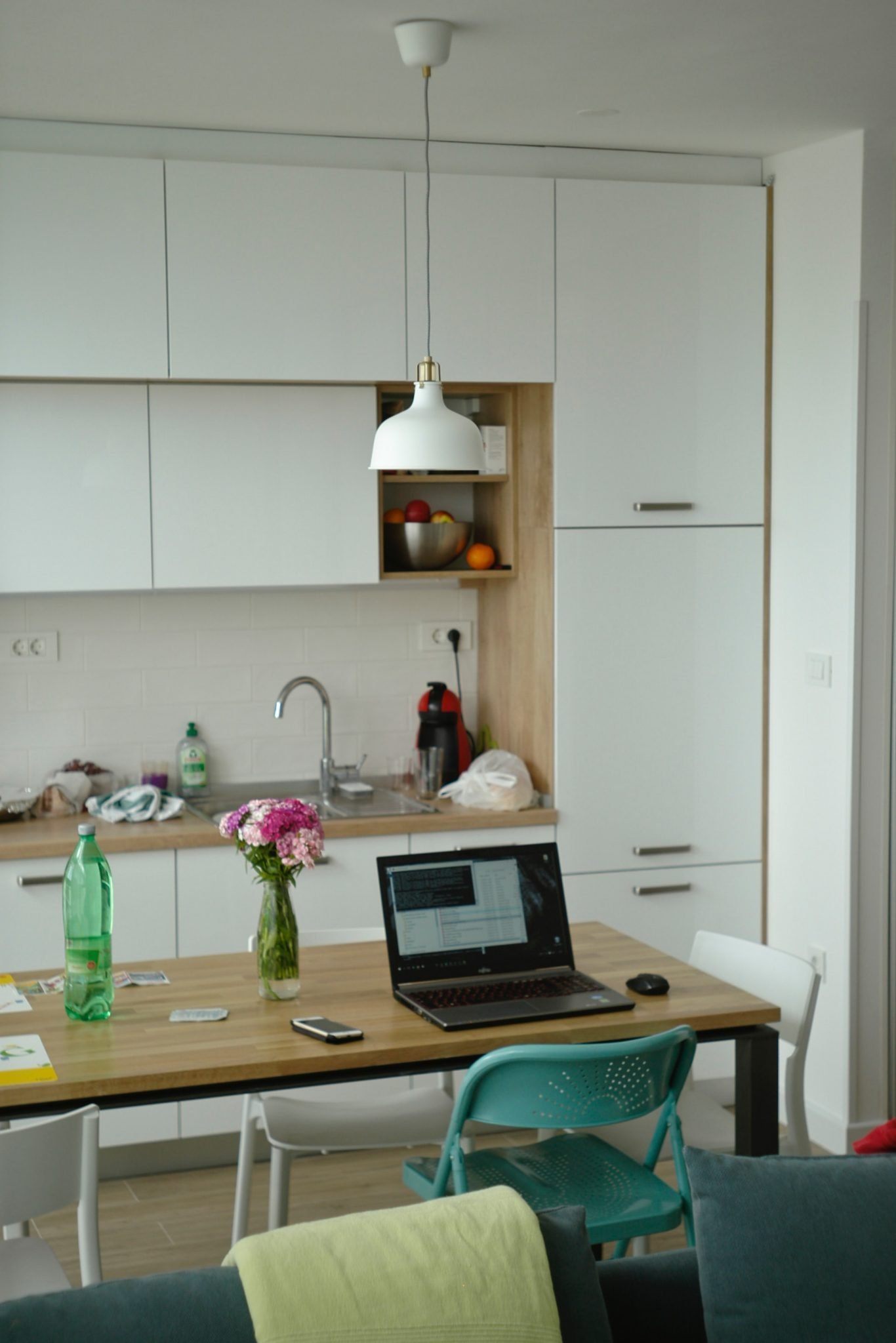 Laptop And Other Items On Kitchen Table With Kitchen In Background, A Great Work-at-home Setup For Laid Off People