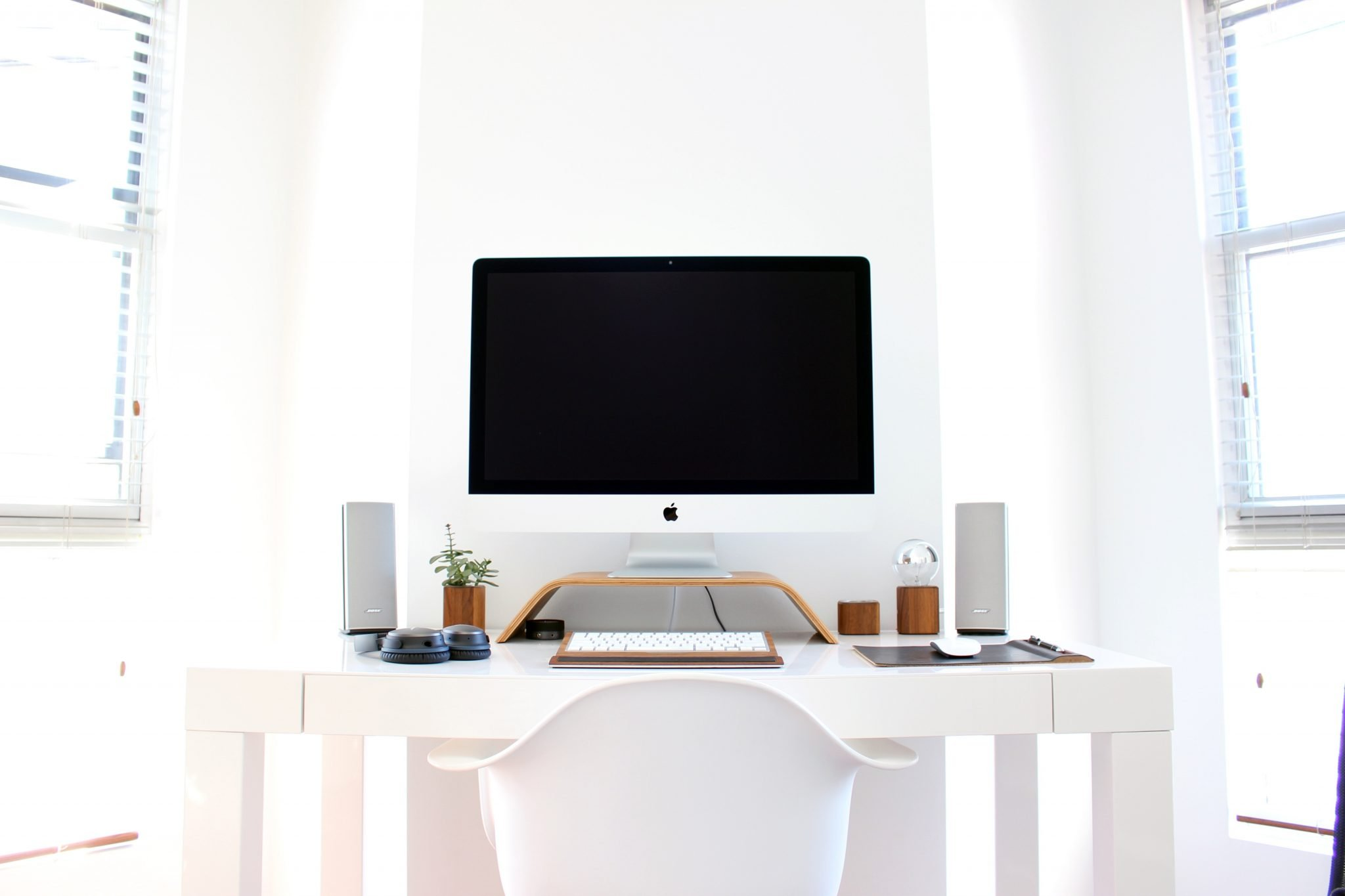 All-white home office with black monitor