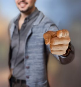 Man Pointing Finger And Blaming Blogging Problems On Someone Else